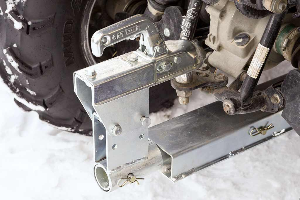 Snow blower hitch ball connection